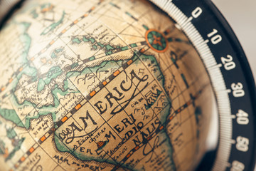 Vintage globe closeup, located on America. Concept for travel commercial.