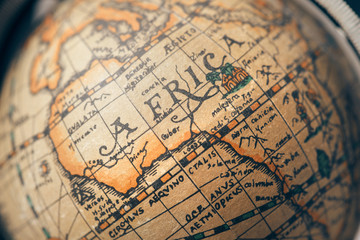 Vintage globe closeup, located on Africa. Concept for travel commercial.