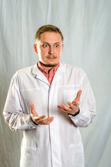 The  portrait of young doctor wearing white coat.
