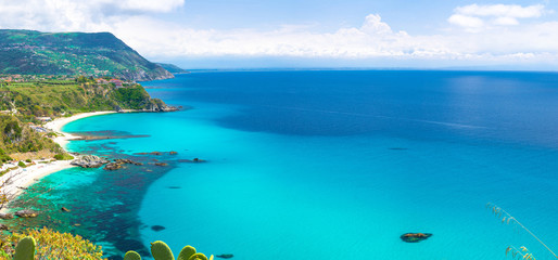 Poster Turquoise Aerial amazing tropical panoramic view of turquoise gulf bay, sandy beach, green mountains and plants, blue sky white clouds background, cliffs platform Cape Capo Vaticano, Calabria, Southern Italy