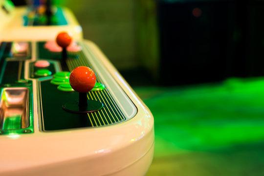 Detail on a blue joystick of an old vintage arcade game