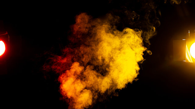 red and yellow smoke on black background