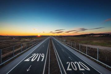 Recess Fitting Gray traffic Driving on open road at beautiful sunny day from 2019 to new year 2020 Aerial view