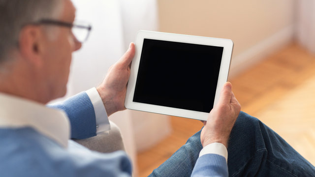 Unrecognizable Elderly Man Using Tablet Sitting At Home, Panorama, Mockup