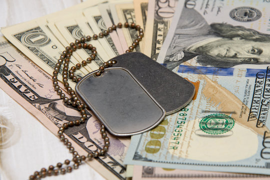 On American dollars are army medallions. Concept: payment for military operations, financing of military personnel, army service under contract, mercenaries.