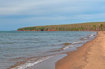 Distant Cliffs on a Quiet Beach