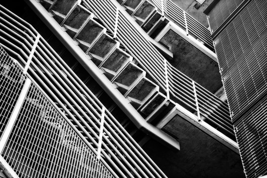 Underneath Staircase on outside of building -black and white