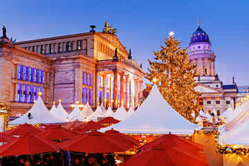 Christmas Market in Berlin, famous traditional European Winter holidays festive market on Gendarmenmarkt square. Germany, Europe. Christmas vacations background, natural processing photo.