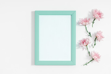 Beautiful flowers composition. Photo frame and pink flowers on white background. Valentines Day, Easter, Happy Women's Day, Mother's day. Flat lay, top view, copy space
