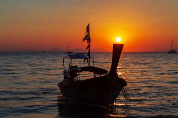 Long tail boat sky sunset background