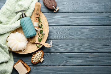 Set of bath accessories on wooden background