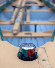 Close up view of rowboat bow area with navigation light