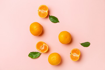 Ripe tasty tangerines on color background