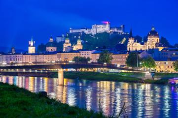 Türaufkleber Dunkelblau A view of Salzburg, Austria along the Salzach River at night.