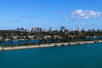 The MacArthur Causeway with Palm Island and South Beach buildings in the background in Miami, Florida.