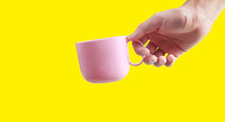 Hand holding plastic cup like a pouring
