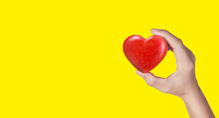 Hands holding a red heart .health donation concepts