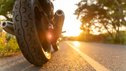 motorcycle in a sunny motorbike on the road riding.with sunset light. copyspace for your individual text. Triumph motorcycle. Wall mural