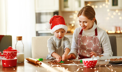 happy family mother and child bake christmas cookies.