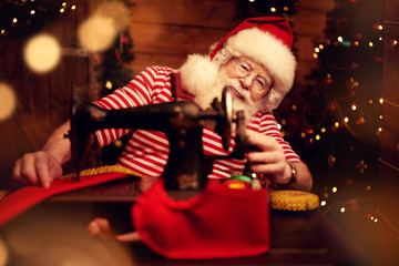 Santa is sewing an outfit