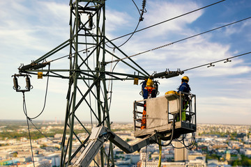 Electrical engineer repairing the electrical network on an elevation boom Wall mural
