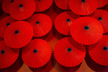 Red umbrellas capture an interesting display of Red patterns.