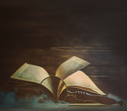 old book and magnifying glass.  atmosphere vintage art image. concept of book wisdom and knowledge, search information. copy space
