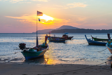 beautiful golden sunrise above fishing boats in Rawai sea Phuket Thailand.