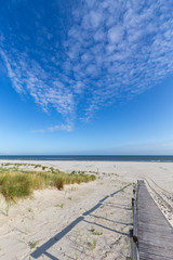 Wall Mural - Beach and North Sea on a summer day on Juist, East Frisian Islands, Germany.
