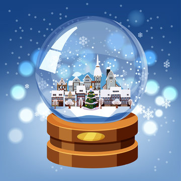 Christmas souvenir snow globe with little town in winter fir-tree