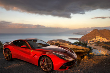Ferrari F12 berlinetta at the viewpoint in Tenerife. Szczecin, Poland-November 2019
