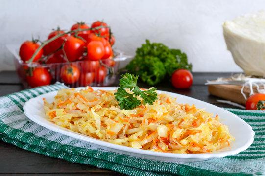 Sauerkraut (german stewed cabbage). Garnish on a white plate on a rustic wooden background.