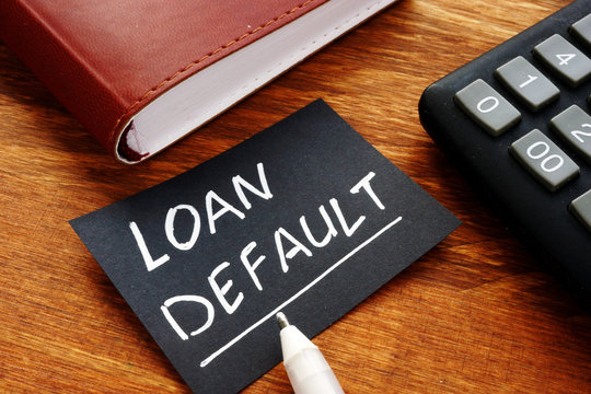 Business photo shows printed text Loan default