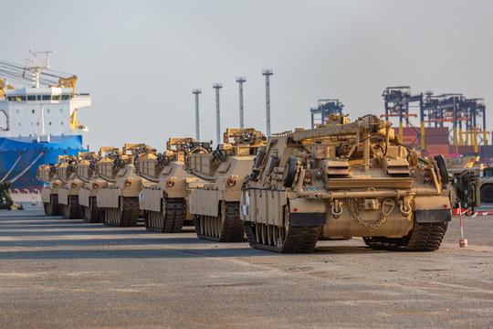 Military vehicle, Convoy of armored vehicle at terminal port, Tank tracks and steel wheels huge panzer.