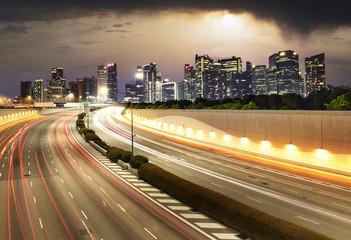 Singapore cityscape skyline during sunset with traffic - Transportation