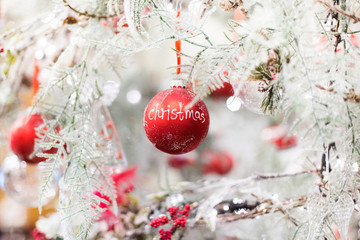 Christmas tree with red ball decorations in a home interior. Beautiful christmas background