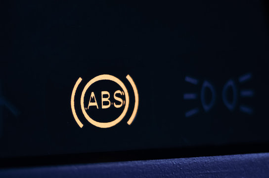 The ABS sensor lights up orange in the car dashboard.