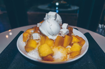 close up view of freshly made bowl of mango bingsoo