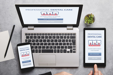 Dental care concept on laptop, tablet and smartphone screen