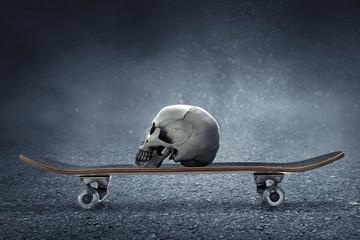 Skull with skateboard on the street