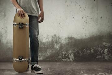 Man holding skateboard on the street