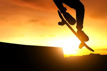 Skateboarder skateboarding at skate park silhouette