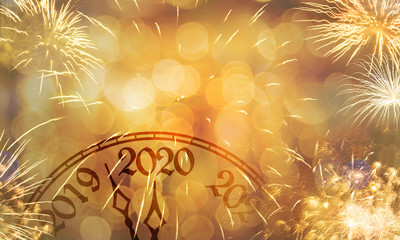 New Year clock near to the midnight of 2020, fireworks golden bokeh background