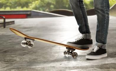 Skateboarder skateboarding at skate park