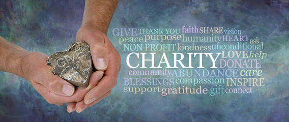 Heart Felt Charity Word Cloud - male hands holding a rustic wooden heart beside a CHARITY word cloud against a masculine grunge rustic stone effect petrol blue coloured background