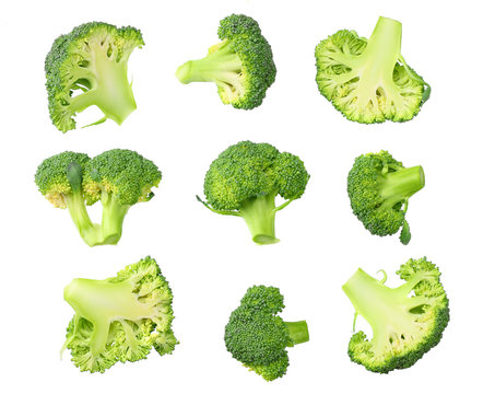 green broccoli with slices and leaves isolated on white background. top view