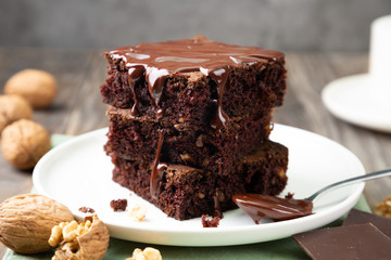 Delicious brownies with melted chocolate on a stack
