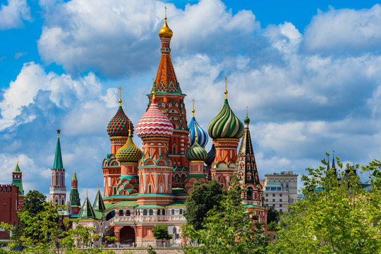 Moscow. Russia. St. Basil's Cathedral on a summer day. Colorful domes of the temple on the background of trees. Red square. Sights capital of Russia. architecture of Moscow. Summer trip to Russia.