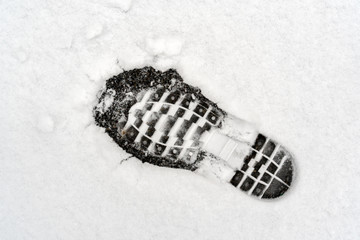 Human footprint on white snow