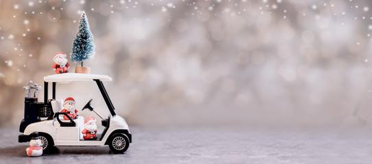 Foto auf Acrylglas Dunkelgrau Christmas decoration with golf car on December.